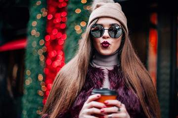 Close up fashion street stile portrait of pretty girl in fall casual outfit Beautiful brunette posing outdoor