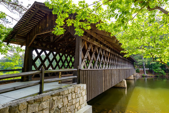 Covered Wood Bridge - A close-up side view of a century old wood Covered Bridge in Stone Mountain State Park, Atlanta, Georgia, USA.