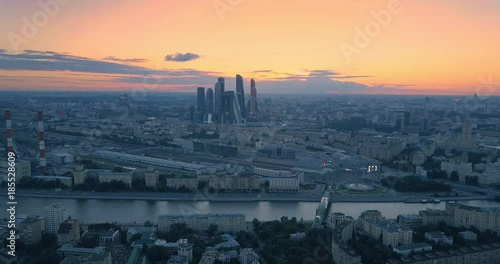 Fotobehang Aerial view of Moscow city skyline at sunset. Flying backwards. 4K UHD.