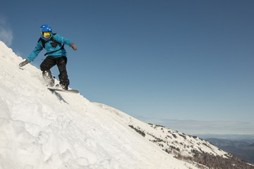 snowboard man have fun and jumping in snow. Winter sport holiday mountains sky resort