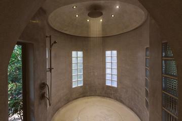 Modern luxury shower design in villa interior. Concrete walls, minimalism