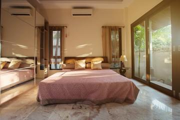 Modern bed room interior in Luxury villa. Big window
