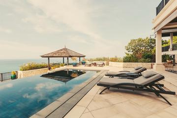 Swimming pool with sea view in luxury villa interior