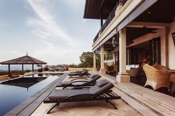Private swimming pool near luxury villa. Sunny summer vacation