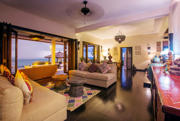 Tropical luxury villa interior, living room with sea view veranda