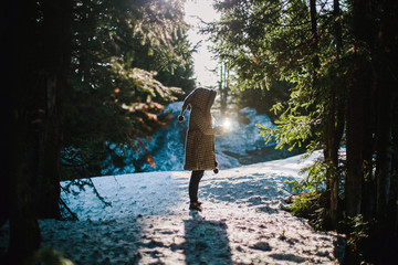 Portrait of woman Holding flashlight in magic forest in winter
