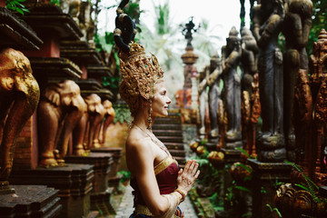 Beautiful white woman in thai traditional costume. Asian queen portrait outdoor