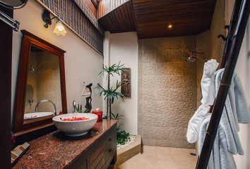 Bathing area interior in luxury asian hotel with towel on bamboo ladder