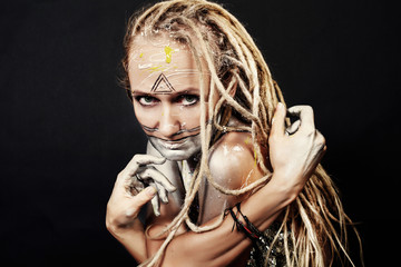 Young woman with creative color makeup and dread locks hair style