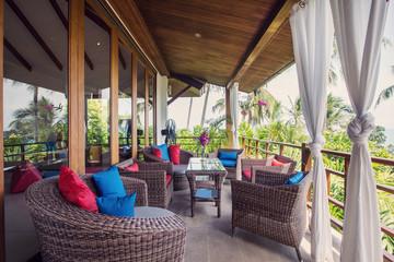 Wicker furniture on veranda balcony in modern interior design