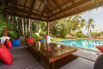 Veranda private swimming pool near luxury villa. Sunny summer vacation