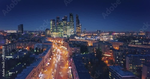 Fotobehang Aerial view of Moscow City skyline at night. Camera flying backwards. Russia.