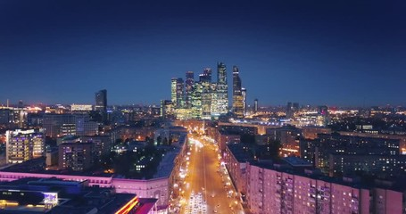Fototapete - Aerial view of Moscow City skyline at night. Camera flying forward. Russia.