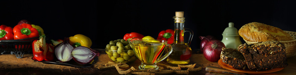 Panorama with olive oil, vegetables and bread