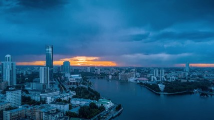 Fototapete - Aerial hyperlapse timelapse city of Ekaterinburg at rainy cloudy sunset, Russia