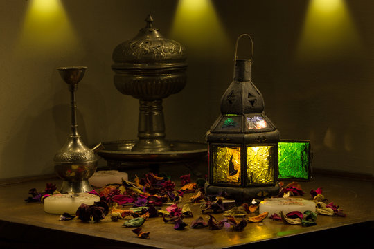 Old Arabic Metal oriental Lantern Colorful Lamp With candles and flowers still life