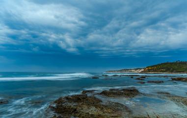 Sunrise Seascape and Rocky Headland