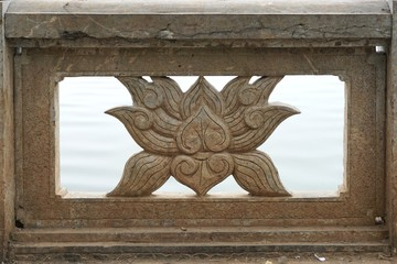 Ancient carved stone lotus panel