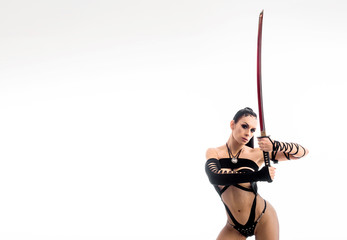 Sexy woman with a sword. Female cosplay ninja. Isolate on white.