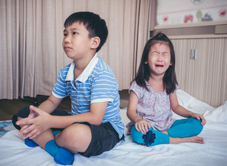 Quarreling conflict of children. Relationship difficulties in family concept.