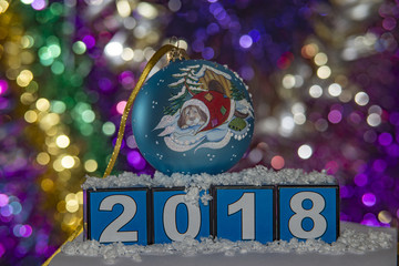 Blue Christmas ball with a dog on the side of 2018.