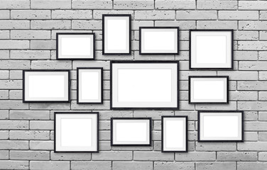 Photo frames mockup, twelve set collection on bricks wall, 3D illustration