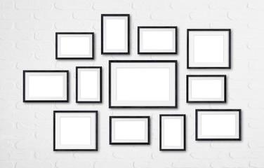 Photo frames mockup, twelve set collection on white bricks wall, 3D illustration