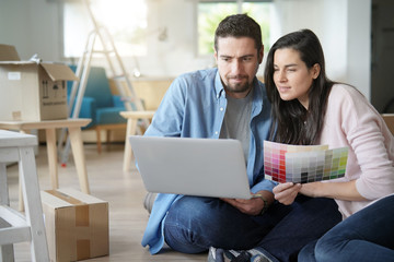 Couple choosing paint colours to reform house