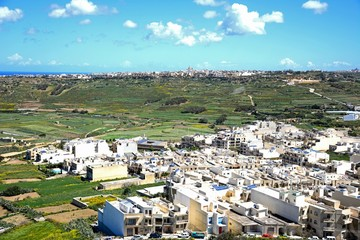 Elevated view looking North towards Marsalforn and the surrounding countryside seen from the citadel, Victoria, Gozo, Malta.