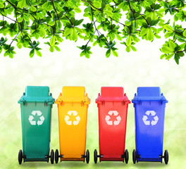 colorful recycle bins with logo on nature background