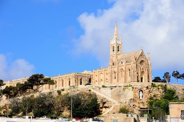 View of Our Lady of Lourdes church on the hillside, Mgarr, Gozo, Malta.