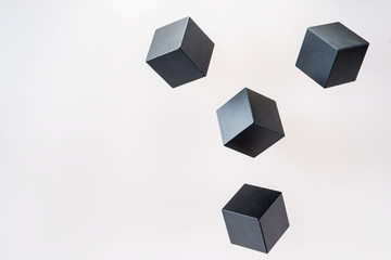 Black wooden cube shapes are floating. Concept of creative, logical thinking. Abstract geometric real floating wooden cube.