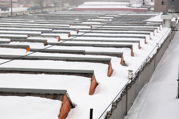 Heavy snowfall covering the whole warehouses