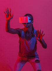 Young black man using VR headset