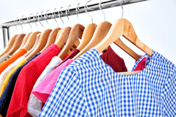 Wall Mural - Colorful clothes on hangers in wardrobe