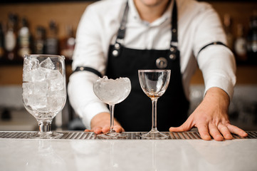 Bartender dressed in a white shirt with glasses