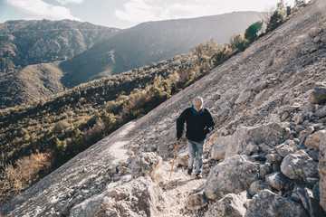 Old man hiking - activity and health concept