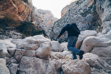 Old man hiking insdide the deepest canyon  in Europe - Activity and Health concept