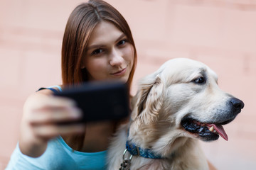Photo of girl doing selfie with dog