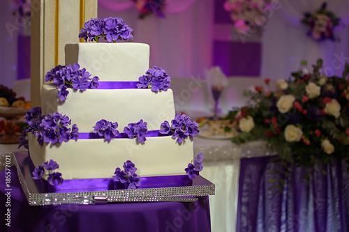 Three tiered white cake with purple flowers stock photo and royalty three tiered white cake with purple flowers mightylinksfo