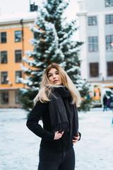 Pretty stylish woman on winter street
