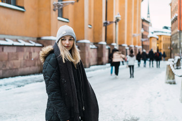 Stylish sensual woman on snowy street
