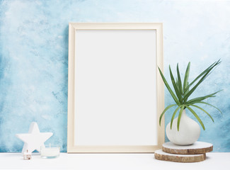 Vertical wooden Photo frame mock up with plants in vase, ceramic decor on shelf. Scandinavian style. Text space