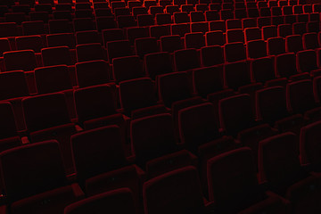Velvet red empty seats in a theater.