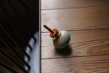 A spinning top on a wooden table.