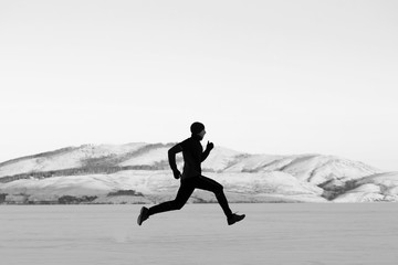 winter trail snow athlete runner black and white photo