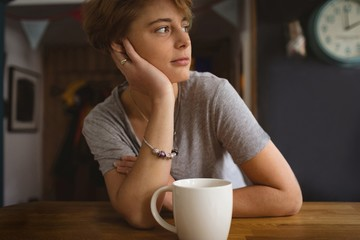 Woman sitting at table with coffee
