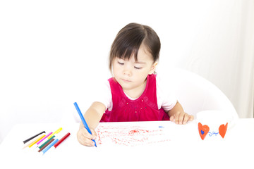 Little Girl drawing with colored markers