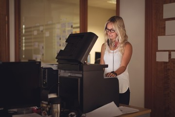 Executive using photocopy machine in office