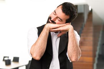 Cool man making sleep gesture inside house